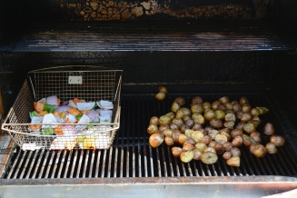 The potatoes are coming along nicely. They're almost ready to transfer to the indirect side of the grill.
